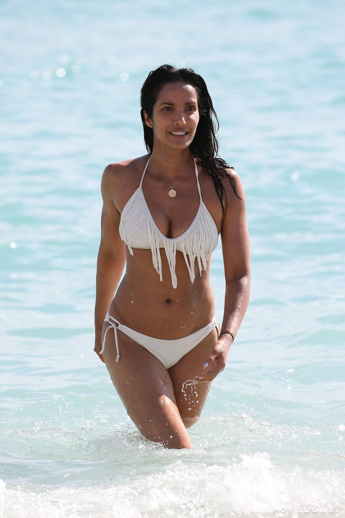 """Padma Lakshmi is currently in Miami promoting her new book, Love, Loss and What We Ate: A Memoir, and on Saturday, the Top Chef host took a break from her busy schedule to hit up the beach with her daughter, Krishna Thea. Clad in a white fringe swimsuit, Padma looked stunning as she flaunted her bikini body while splashing around in the ocean. In addition to showing off her fit figure, Padma has been documenting her adventures on Instagram. On Friday, she shared a photo of her colorful lunch, and hours later, she posted a cute snap of her and Krishna using the deer filter on Snapchat, writing, """"#littlehands and I messing around with filters! Not sure why I find this so funny but I do!!!! #mommyandme."""" It's safe to say that Padma and her daughter are having an excellent time in Florida.       Related:                                                                                                           Look Back at Last Year's Hottest Swimsuit Moments"""