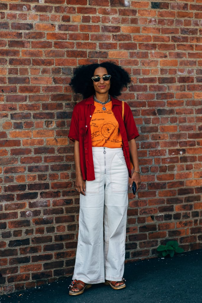 Flared pants, light layers, and platform sandals are simple to execute and exude a slightly '70s vibe.