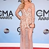 Carrie Underwood looked flawless in a pale pink, beaded gown on the red carpet at the Country Music Association Awards in Nashville on Wednesday night.