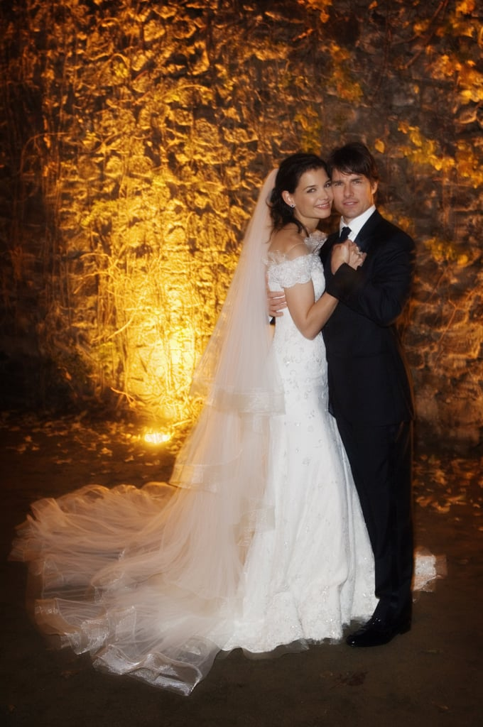 Tom Cruise and Katie Holmes tied the knot in Italy in 2006. Katie's longtime friend, designer Giorgio Armani, designed her off-the-shoulder confection.