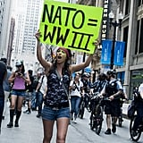 This woman marched through the streets of Chicago with her anti-NATO sign.