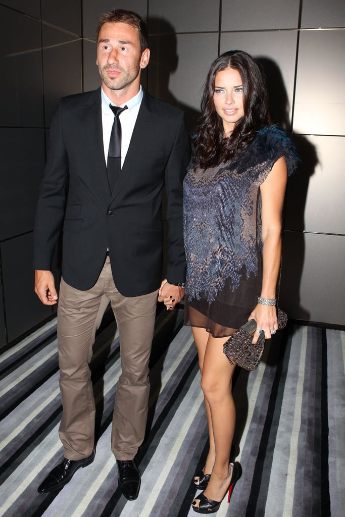 "Adriana Lima held hands with her husband Marko Jaric last night as they headed into an event hosted by the Brazil Foundation Gala at the W Hotel in South Beach. The supermodel attended the Miami bash in support of her home country, and headed inside for a dinner with other famous Brazilians like racecar driver Helio Castroneves, model Isabeli Fontana, and Marc Jacobs's on-off boyfriend Lorenzo Martone. Lorenzo and Isabeli emceed the soiree, which raised $72,000 for the organization. There was an additional reason for Marko and Adriana, who have been married for three years, to celebrate. It was confirmed last week that Adriana Lima is pregnant with the couple's second child! They're already parents to 2-year-old Valentina. In a statement, Adriana said, ""The entire family is very excited, especially Valentina. She keeps blowing kisses to my belly and saying, 'Kisses for the baby.'"""