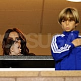 Victoria Beckham looked after her kids Harper and Romeo while David Beckham took the field.