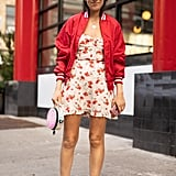 Add a little coverage via a bomber jacket over your favorite Summer dress, and finish with smart, walkable tennis shoes.