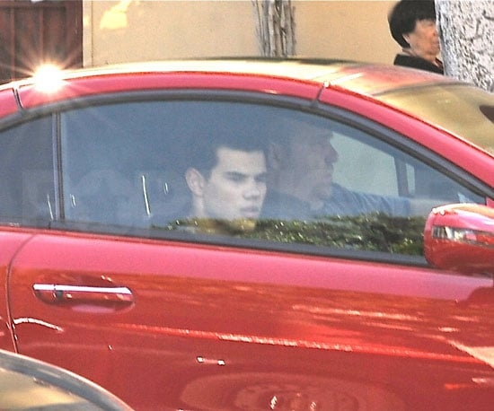 Slide Photo of Taylor Lautner in a Red Mercedes Benz in LA