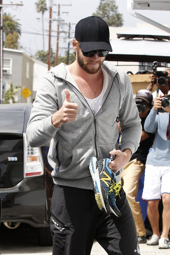 Liam Hemsworth flashed a thumbs-up.