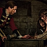 Jamie and Claire protect each other from the brunt of Black Jack's wrath