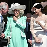 Charles was clearly amused by Meghan during an event at Buckingham Palace in May 2018.