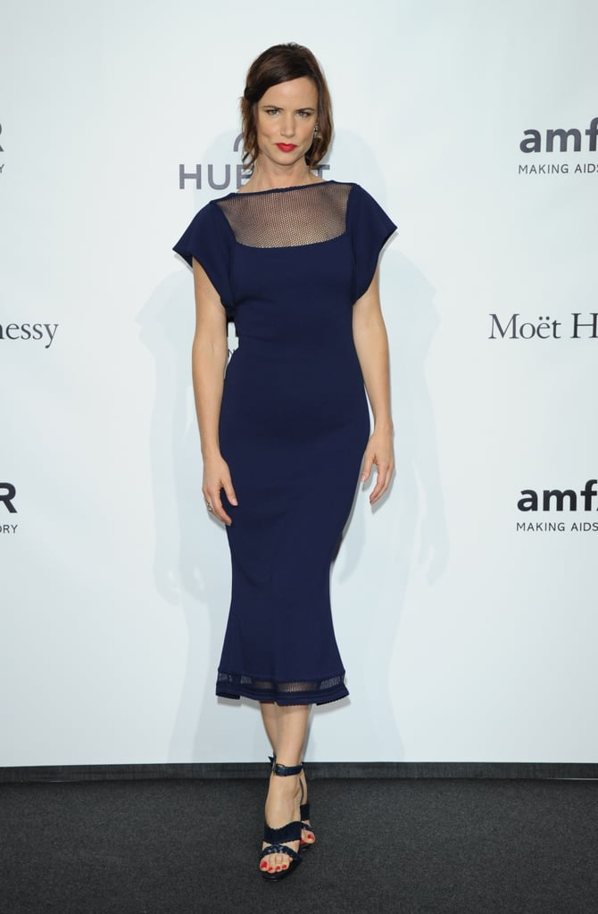 Juliette Lewis looked sophisticated in a navy mermaid-style midi dress and matching sandals at the amfAR Milano gala event in Milan.