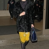Nicole Kidman gave her Winter travel style a jolt of yellow and then threw on a furry black coat.