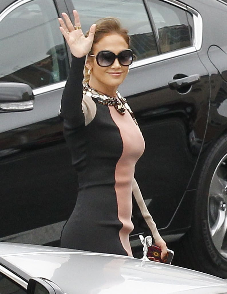 Jennifer Lopez waved on the way into her press conference to announce her new tour.