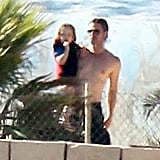 Shirtless Brad Pitt carried Knox at a water park in Malta.