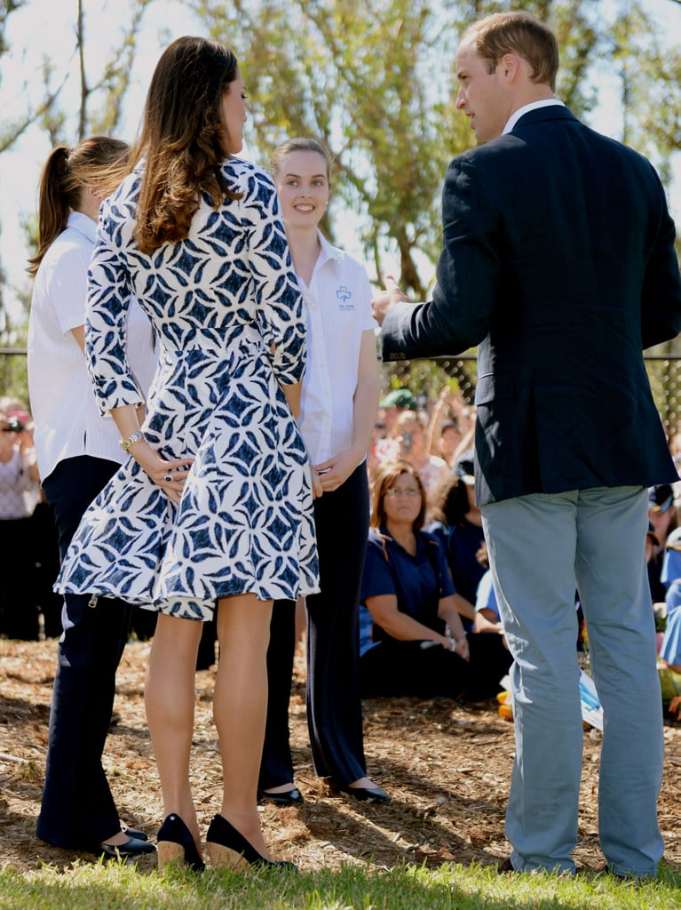 Kate made sure to keep control of her printed DVF dress as she and William met with young girls during their tour of Australia in April 2014.