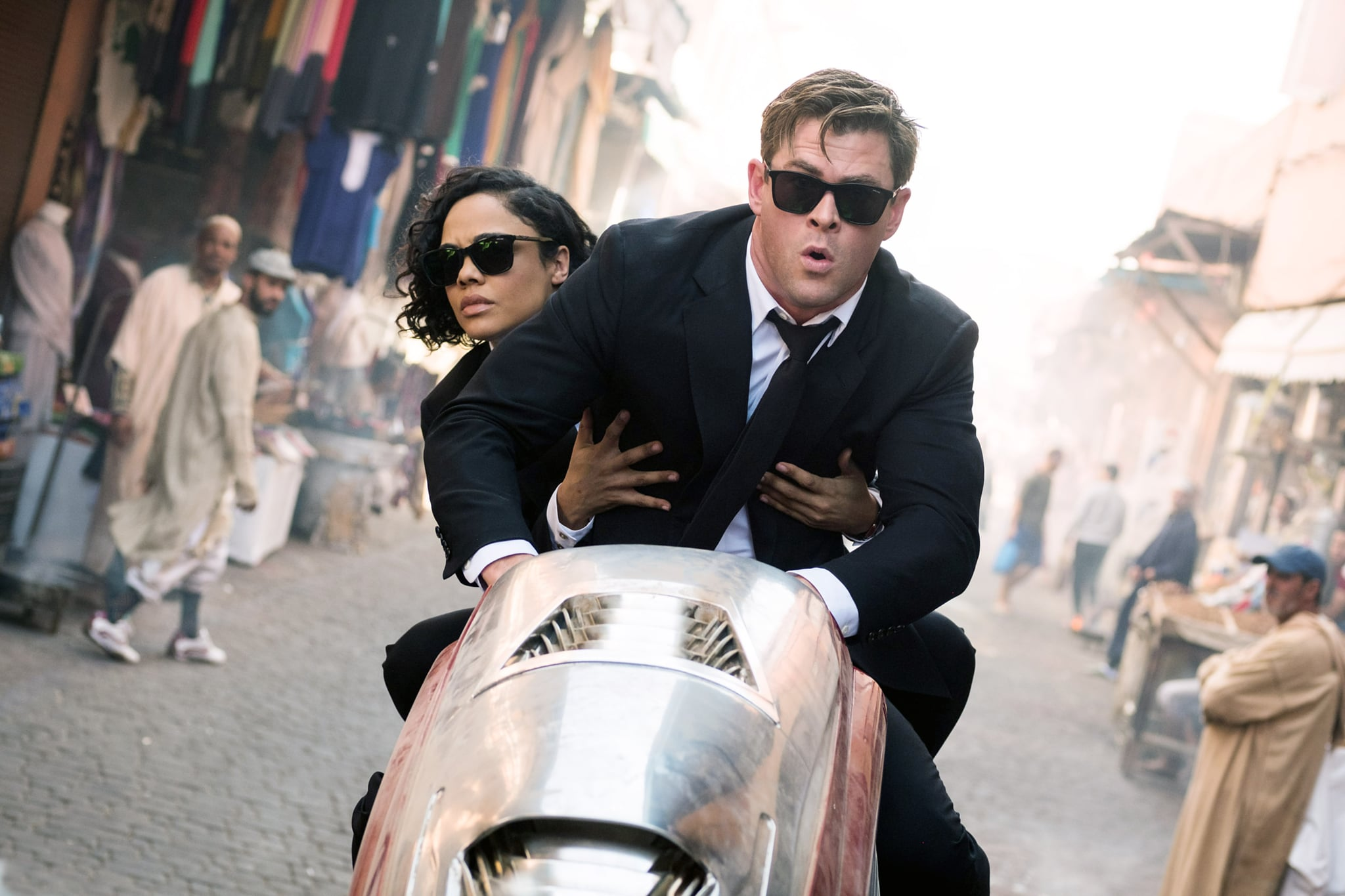 MEN IN BLACK: INTERNATIONAL, (aka MIB: INTERNATIONAL), from left: Tessa Thompson, Chris Hemsworth, 2019. ph: Giles Keyte /  Columbia Pictures / courtesy Everett Collection
