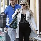 Jessica Simpson kept her baby bump comfortable in a black tank while out with Eric Johnson.