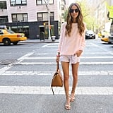 A Pink Sweater, Floral Shorts, and Lace-Up Sandals