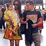 Victoria Beckham huddled to Harper and Brooklyn before taking a flight out of LA.