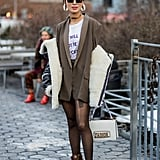 With a Slogan Tee and a Blazer, a Shearling Coat, and Ankle Boots