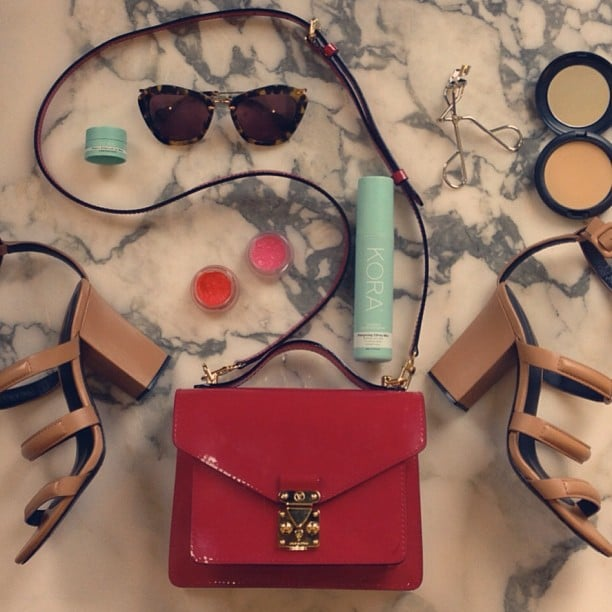 Ooh! Miranda Kerr bared all when she shared a snap of what she keeps in her handbag: an eyelash curler, Kora Organics prods, lipgloss, pressed powder and some seriously cool sunnies. Loving those shoes, too. Source: Instagram user mirandakerr