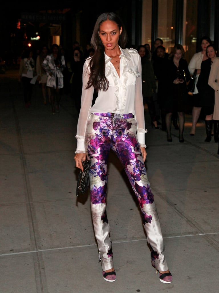 Joan Smalls was spotted wearing Prabal Gurung's purple floral pants at NYFW.   More Vince Camuto...