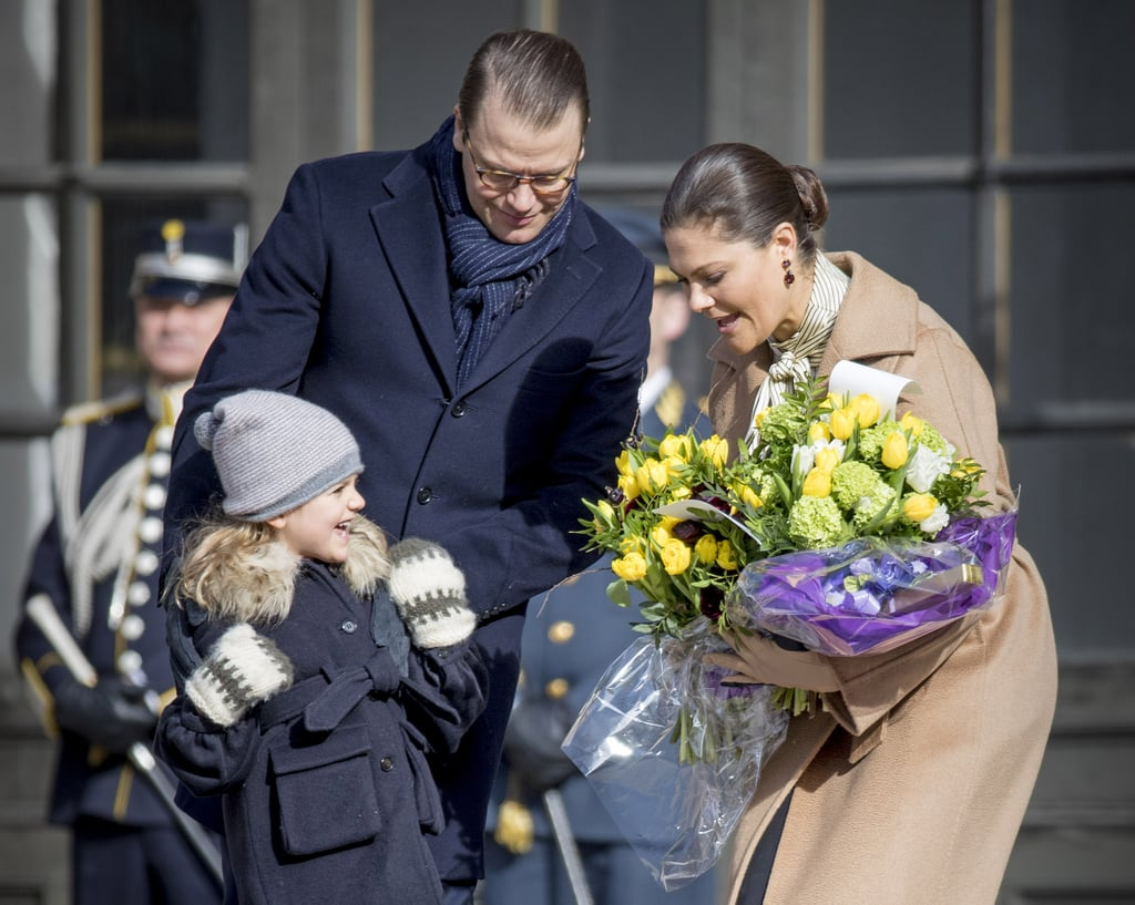 Princess Victoria was honored with a name day ceremony in Sweden on Sunday, and she had the support of Prince Daniel and their adorable kids, Princess Estelle and Prince Oscar. Victoria — who is first in line to the Swedish throne — was welcomed with a gun salute and a bouquet of flowers, but her children ultimately stole the show. One-year-old Oscar was spotted clinging to a stuffed polar bear toy, while 5-year-old Estelle flashed several sweet smiles and carried her mom's flowers. The event is celebrated every year on March 12, and in Sweden, each calendar day corresponds to a name belonging to a royal family member or saint. Honestly, Estelle and Oscar might be giving Prince George and Princess Charlotte a run for their money.