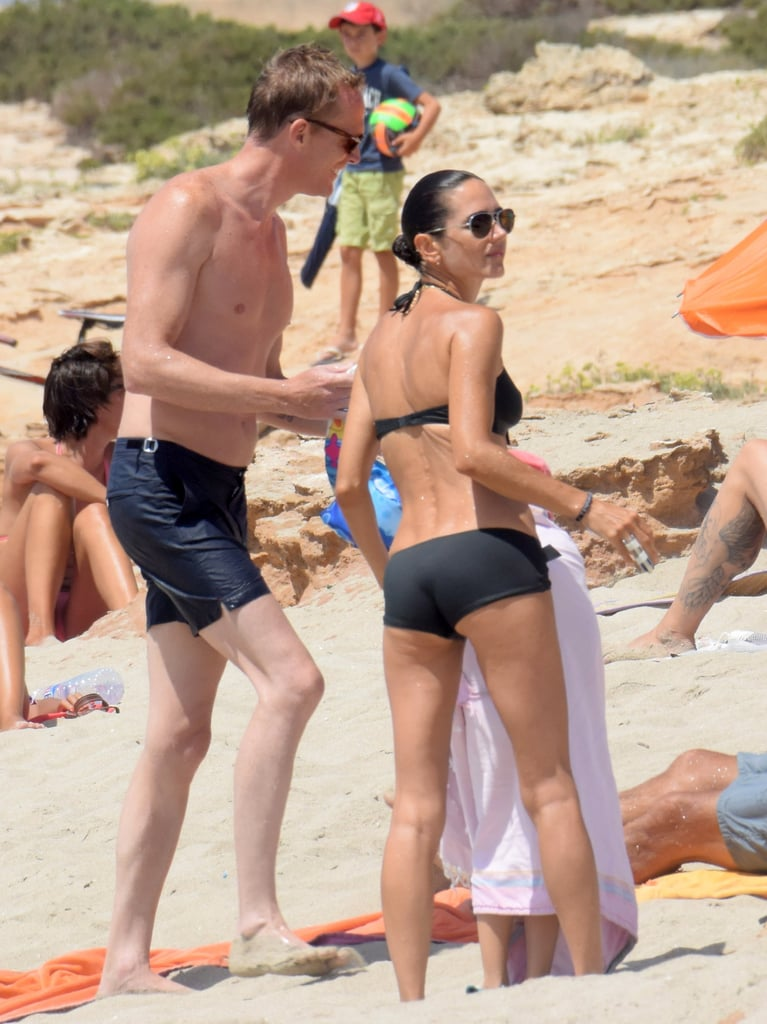 Jennifer Connelly and Paul Bettany enjoyed a fun-filled day on the beach in Formentera, Spain, with their 5-year-old daughter, Agnes, on Thursday. The couple seemed happy and relaxed as they spent time in the sand, and even though Jennifer looked to be nursing a finger injury (she was spotted with a splint on her right hand), it didn't deter her from hitting the ocean for a quick dip. The actress, who has been filming Granite Mountain with Miles Teller and Jeff Bridges, showed off her fit figure in a black Eres bikini, while Paul — who recently starred as Vision in Captain America: Civil War, went shirtless in a pair of swimming trunks. Jennifer and Paul met in 2001 while starring together in A Beautiful Mind and tied the knot two years later; we last saw them on the red carpet for a screening of Civil War with Paul's costar Robert Downey Jr. in May. See more Hollywood couples whose love has stood the test of time and the best bikini moments of the year so far.