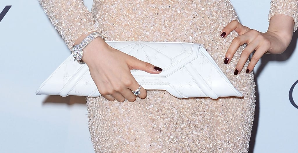 Fan Bingbing carried a fun geometric bag and wore a diamond-encrusted watch and ring.