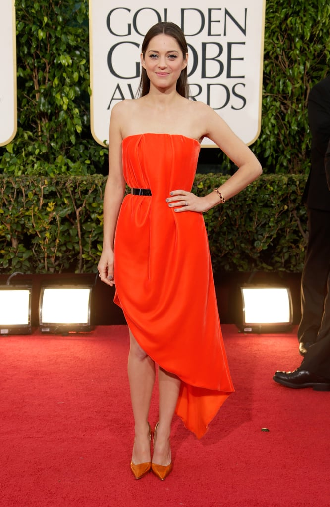 Marion Cotillard also chose a Christian Dior number for the 2013 Golden Globe Awards. Hers was an orange-red strapless asymmetrical dress, which she wore with matching pumps.