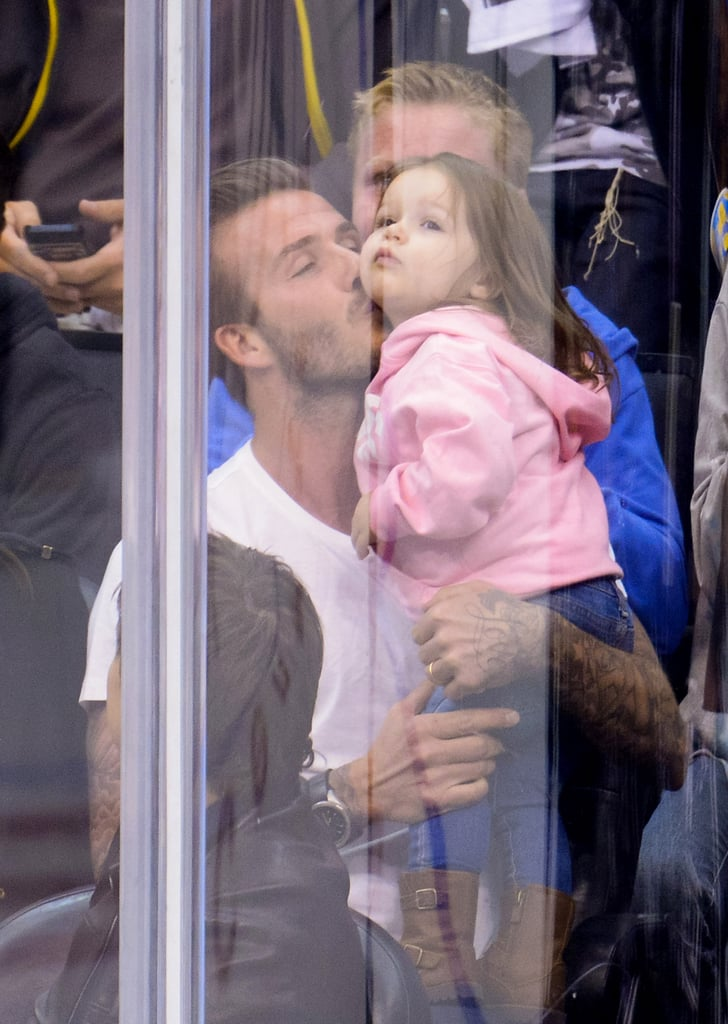 In May 2013, David planted a sweet kiss on Harper at an LA Kings game.