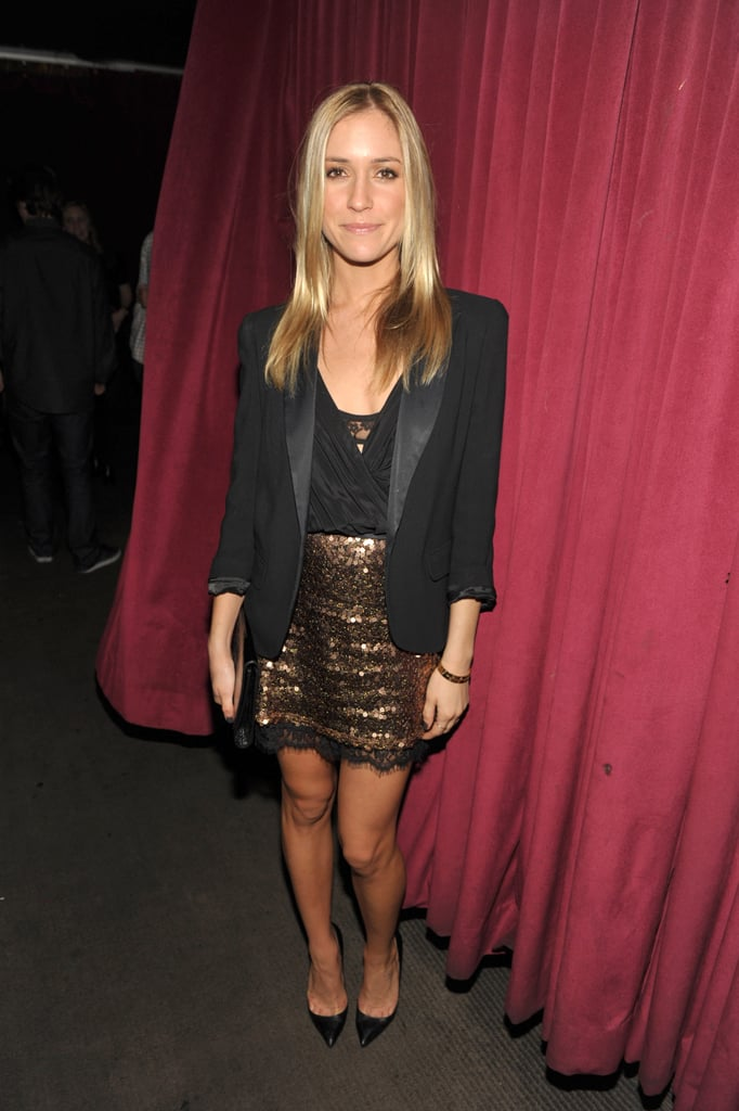 Kristin Cavallari suits up in the perfect party look with a gold, sparkly mini and a chic black blazer.