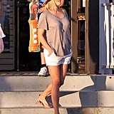 Don't mind Reese looking island chic in an oversize oatmeal tee, white shorts, and strappy sandals.