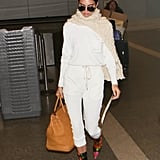 Kendall Jenner couldn't resist making these Balenciaga floral boots part of her airport outfit.