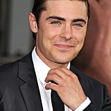 Zac Efron straightened his tie at the premiere of The Lucky One in LA.