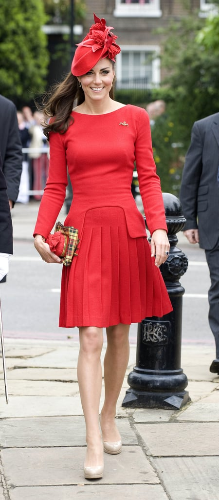 Kate Middleton wore a bright red Alexander McQueen dress with long sleeves and pleated skirt plus nude LK Bennett heels.