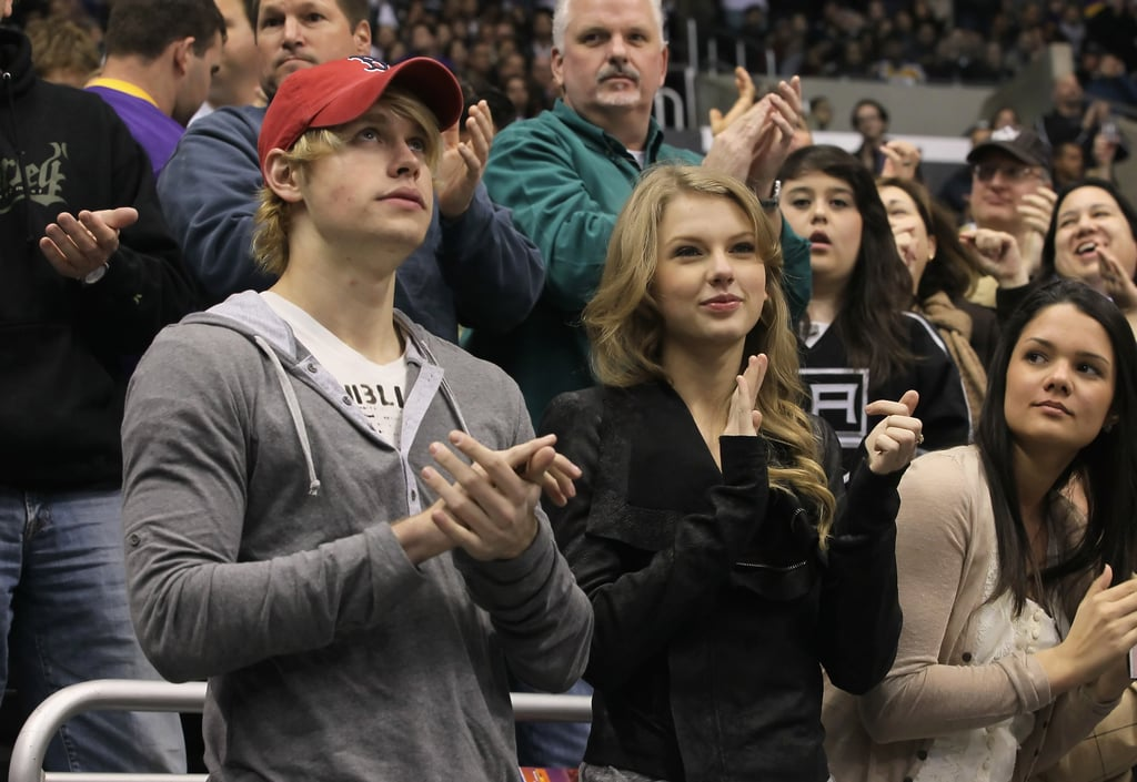 """Taylor Swift and Glee's Chord Overstreet were side by side last night to see the Los Angeles Kings take on the Minnesota Wild at LA's Staples Center. The duo watched as the home team defeated their hockey visitors with a final score of 4-2. Taylor and Chord have been subject to romance rumors recently, and their game time won't do much to stop those stories. Their hanging out comes shortly after Taylor apparently reunited with her ex, Jake Gyllenhaal, over dinner in Tennessee. Taylor's Nashville hometown is something she and Chord actually have in common, as he was born there to a singer-songwriter dad named Paul Overstreet. Chord was able to break from his award season partying to have fun with Taylor, but it was evidently an exhausting day anyway. He tweeted to fans just before bed to write, """"Long day, time for some good ole fashion sleep."""""""