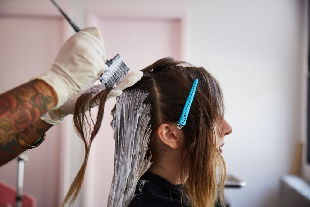 As she applied the bleach with a brush, Jeanise combed through my strands. She didn't want to leave any extra bleach residue hanging out on my hair, because that can add gross green tones to what should eventually be a bright blond.