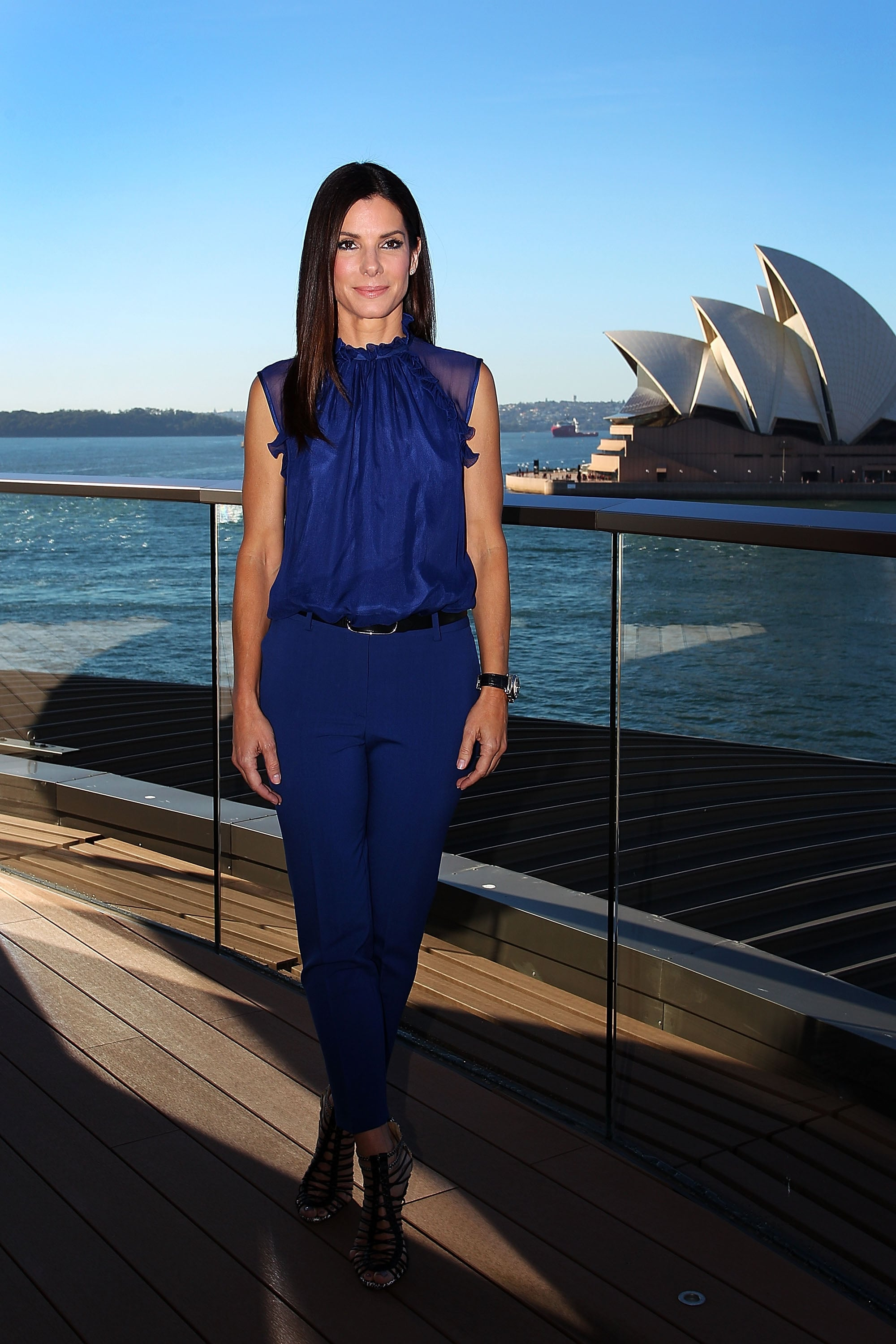 For the film's Sydney photocall, Sandra slipped into a more casual but sophisticated cobalt blue blouse and pants — then finished with edgy, strappy sandals.