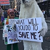 A polar bear with a message about extinction stood next to a costumed Mario promoting his entertainment services.