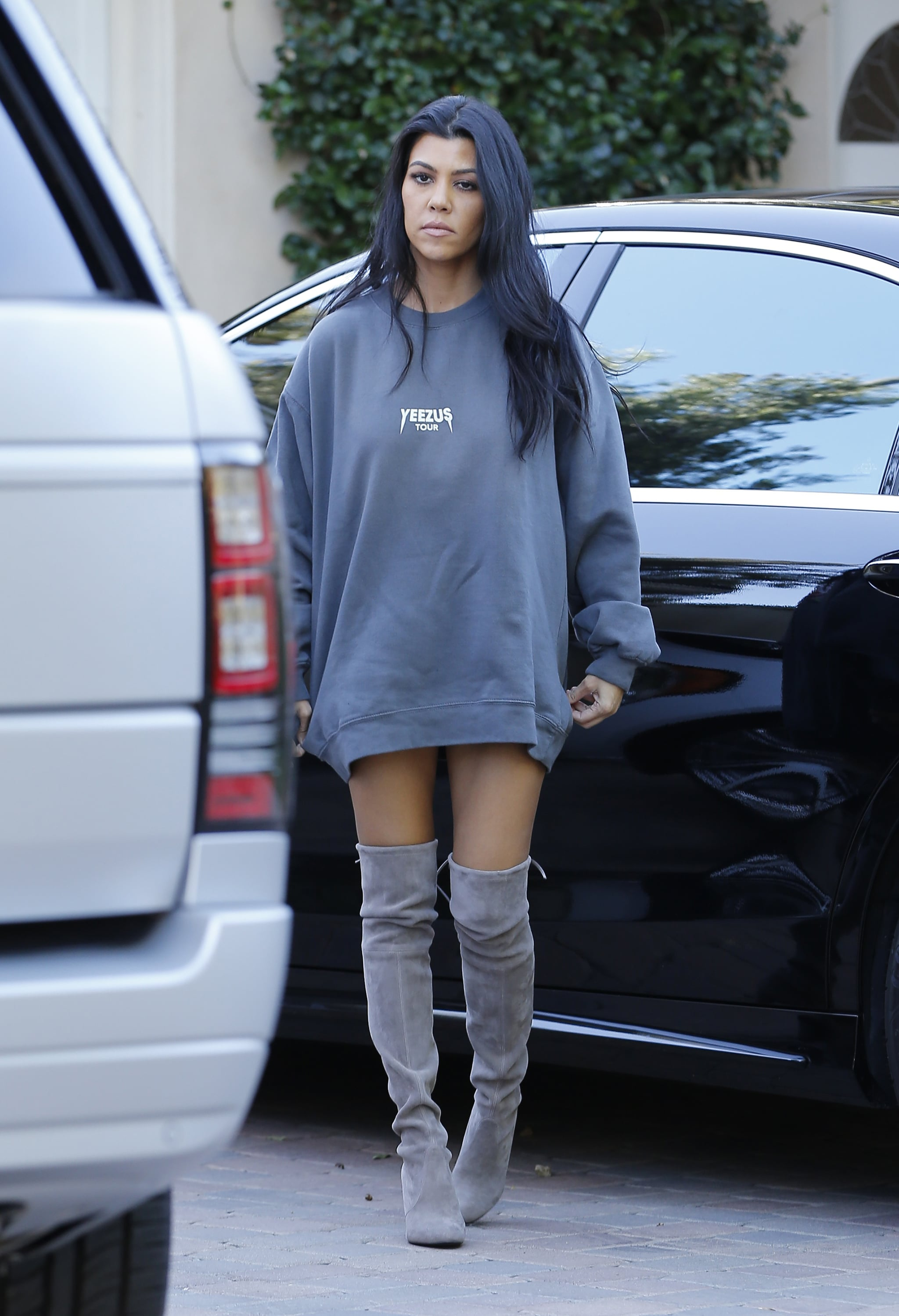 Kourtney Kardashian Kim Kardashian Is Lampshading Like Whoa In These Lace Up Boots Popsugar