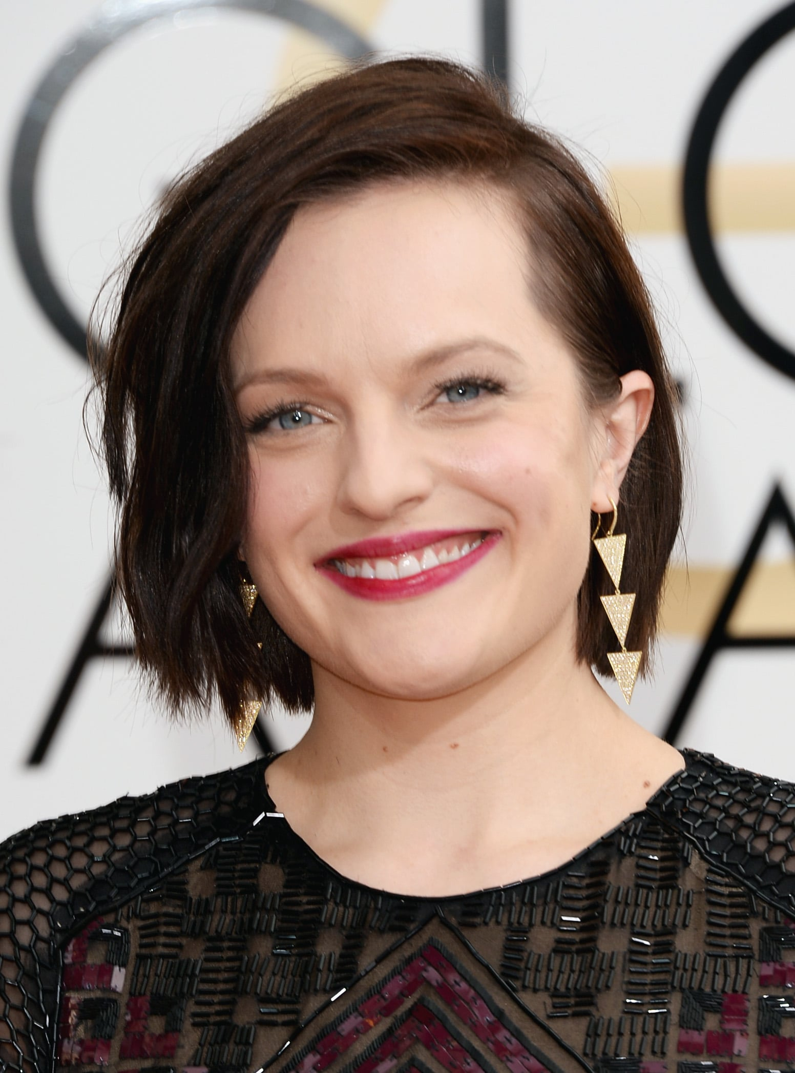 Elisabeth Moss complemented her beaded gown with fuchsia lips and coal-rimmed eyes.