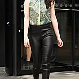 During Paris Fashion Week Fall/Winter 2012, the budding fashionista softened her rock-chic leather pants with a feminine floral blouse, both by Balenciaga.