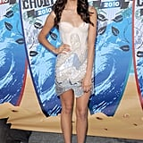At the 2010 Teen Choice Awards, Nina wowed in a sparkly corset-style Alex Perry dress.