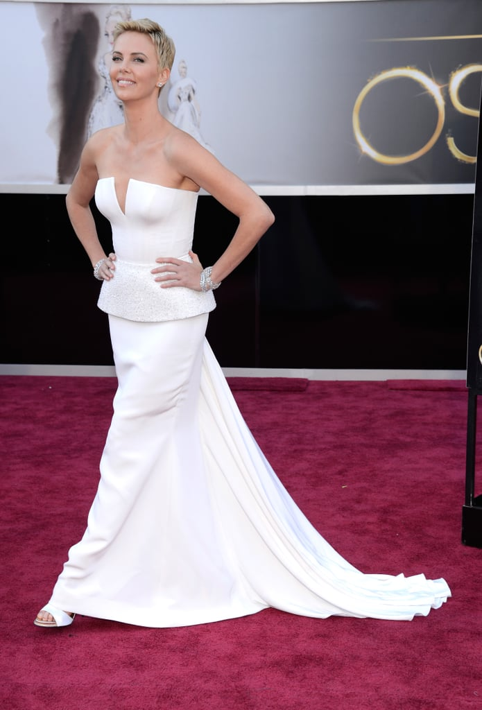 Charlize Theron struck a pose in a strapless white Christian Dior Couture gown at the Academy Awards in LA this evening. She's among the many presenters at the big show, including Mark Wahlberg, Meryl Streep, and Channing Tatum. This isn't Charlize's first 2013 award season stop, though — she hit the red carpet at the Berlin Film Festival's Cinema For Peace Gala earlier this month and attended the Crystal Award Ceremony at the World Economic Forum in January.  Make sure to vote on your favorite Oscars fashion and beauty with our polls, and check back for more Academy Awards action throughout the night!