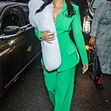 Wearing a green Christian Siriano suit.