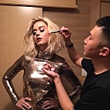 Here is a shot of Nguyen doing Katy's makeup.