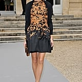 Olivia Palermo outfitted a bold print outside of Dior at PFW.