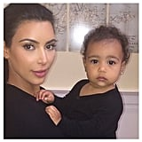"Kim and North did their best ""paparazzi"" faces for the camera in this November 2014 snap."