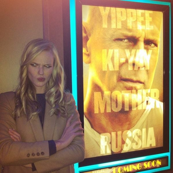 Anne V. posed next to a movie poster. Source: Twitter user AnneV