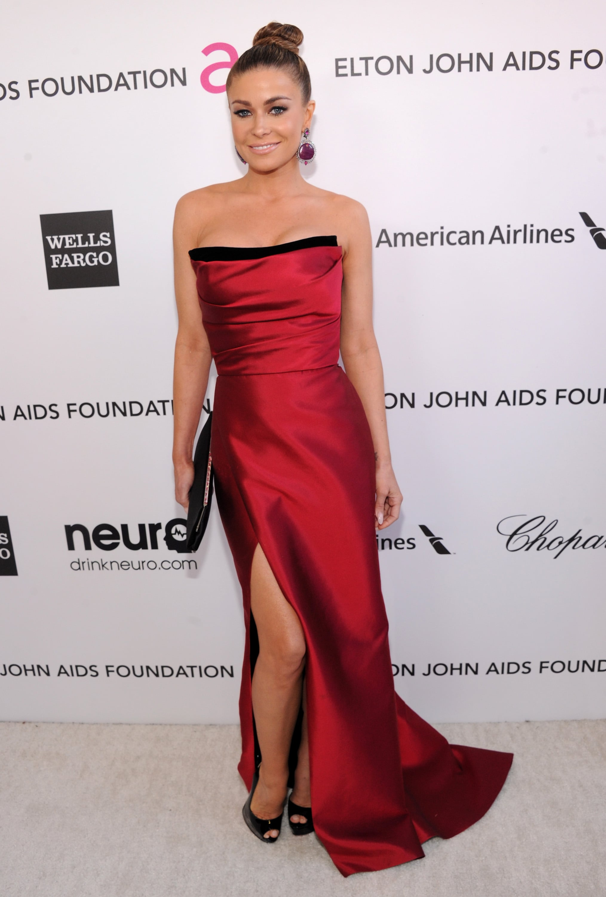 Carmen Electra showed off her legs in a red dress with a high slit at Elton John's Oscar party in LA.