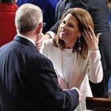 Michele Bachmann gets ready to listen to the speech.